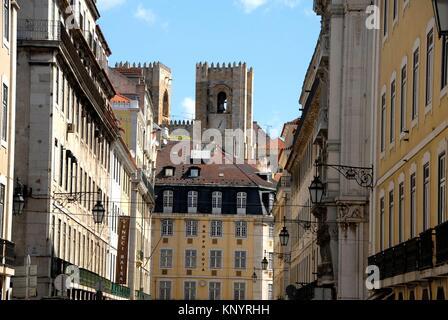 Rua do Comercio with Lisbon Cathedral - Se Patriarcal - in the background. Baixa, Lisbon, Portugal. - Stock Photo