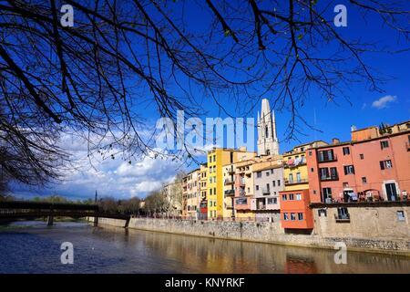 the Onyar River. In the background the tower of Sant Feliu or San Felix Church stands out. City of Girona, Catalonia, - Stock Photo