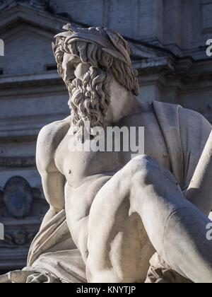 Sculptures of the Fountain of the Four Rivers in Piazza Navona, Rome, Italy - Stock Photo
