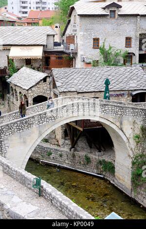 Bridge over Radobolja stream in Old Town ''Stari Grad'' of Mostar, Bosnia and Herzegovina - Stock Photo
