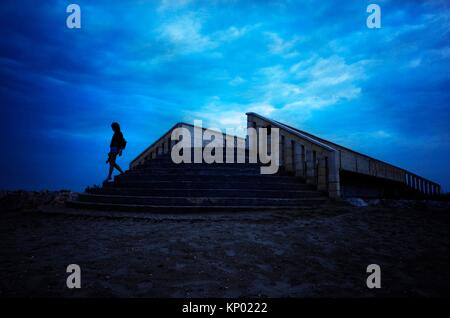 girl walking on the beach at sunset, Valencia - Stock Photo