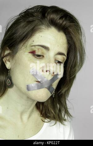 silence of a battered woman - Stock Photo