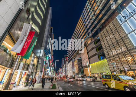 Ginza, Tokyo - December 2017 : Illuminated billboards in crowded Chuo dori street at Ginza luxurious shopping District - Stock Photo