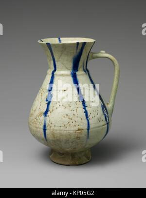 White Ewer with Blue Streaks. Object Name: Ewer; Date: 12th-13th century; Geography: Attributed to Iran, Kashan; - Stock Photo