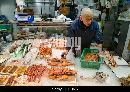 Seafood seller in Nishiki Market, Kyoto, Japan. - Stock Photo