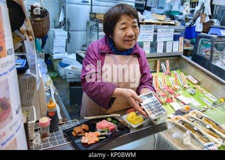 Sashimi fish seller in Nishiki Market, Kyoto, Japan. - Stock Photo