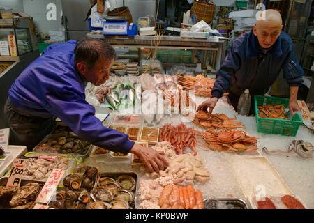 Seafood sellers in Nishiki Market, Kyoto, Japan. - Stock Photo