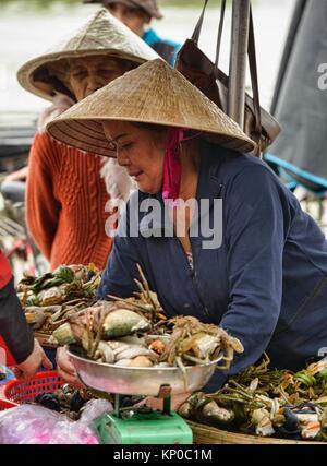 Crab vendor in the fish market, Hoi An, Vietnam. - Stock Photo