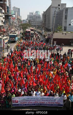Bangladeshi garments workers attend a demonstration protest for their due salary and wages in front of National - Stock Photo