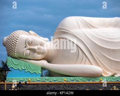 Sleeping Buddha in Vietnam, My Tho, Mekong Delta river area. Vinh Trang Pagoda complex. - Stock Photo