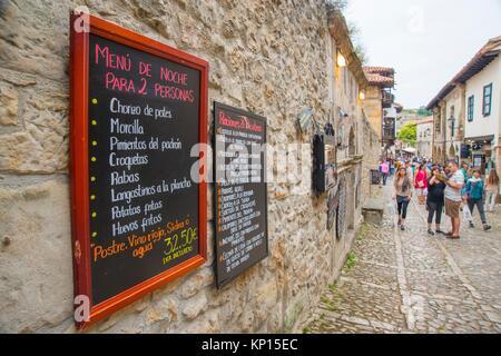 Menu boards and main street. Santillana del mar, Cantabria, Spain. - Stock Photo