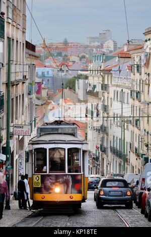yellow vintage tramway streetcar Alfama district Lisbon Portugal. - Stock Photo
