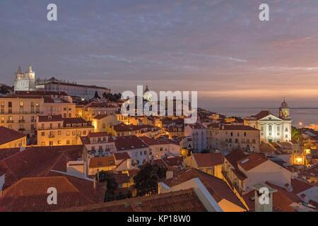 Alfama district night Santa Lucia mirador Lisbon Portugal. - Stock Photo