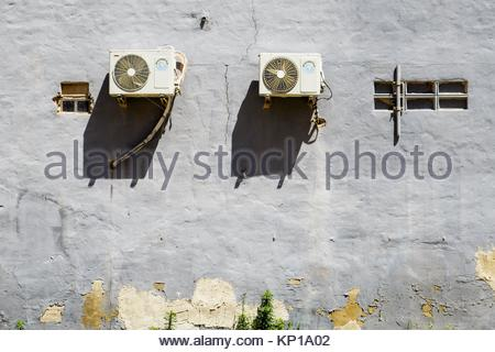 Air conditioner units outside on wall of building - Stock Photo