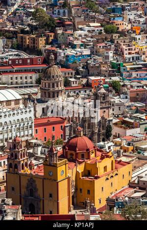 High angle view of the yellow church of Parroquia de Basílica Colegiata de Nuestra Señora de Guanajuato, the Cathedral - Stock Photo