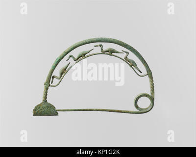Bronze bow fibula (safety pin) with four ducks MET DP123998 252551 Villanovan, Bronze bow fibula (safety pin) with - Stock Photo
