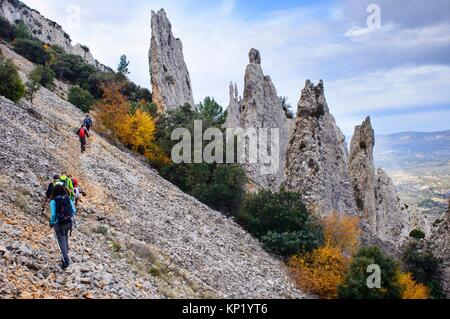 Walker walking the mountain, under the knives of the Quatretondeta Friars, Alicante, Valencia, Spain - Stock Photo