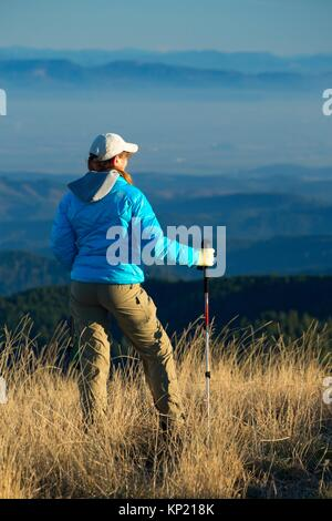 Hiker on Marys Peak summit, Marys Peak Scenic Botanical Area, Siuslaw National Forest, Oregon. - Stock Photo