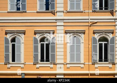 window shutters on a building in monaco - Stock Photo