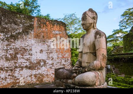 One of the Buddha Statues on the upper platform of Vatadage Temple, The Quadrangle, Ancient City of Polonnaruwa, - Stock Photo