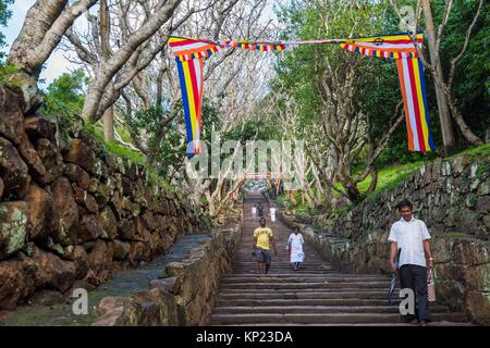 Tourists and Pilgrims Descending the Great Stairway of not less than 1,840 Steps to the top of Mihintale Mountain, - Stock Photo
