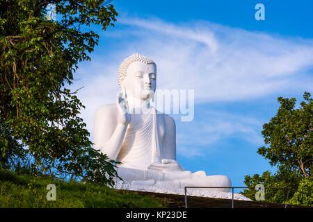 Giant Seated Buddha at Mihintale Monastery, Anuradhapura District, North Central Province, Sri Lanka, Asia. - Stock Photo