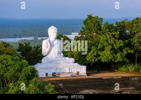 Giant Seated Buddha at Mihintale Monastery, Anuradhapura District, North Central Province, Sri Lanka, Asia. - Stock Photo