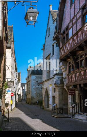 Le Carroi Museum and La Maison Rouge in Narrow Old Town Street with Cobble Stone (Rue Voltaire) of Chinon. Indre - Stock Photo