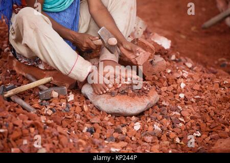 Bangladeshi Child labor break bricks at Postogola brick breaking yard in Dhaka, Bangladesh, on June 3, 2017. With - Stock Photo