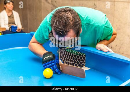 Blind people playing showdown game. Showdown is a fast-moving sport originally designed for people with a visual - Stock Photo
