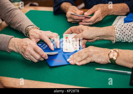 old people playing bridge game - Stock Photo