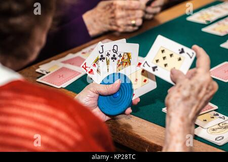 old women playing canasta game - Stock Photo