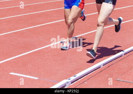 young girls doing Hurdling on a the track and field stadium CIAT in Santa Cruz de Tenerife city during the 22nd - Stock Photo
