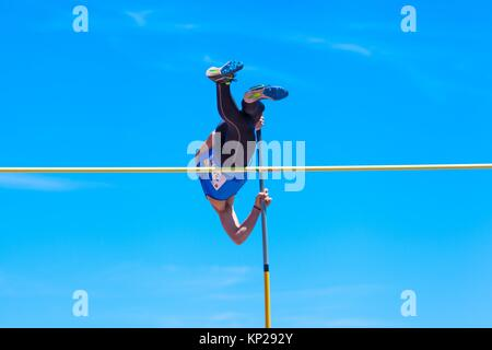outdooor young adult male pole vaulting competition held 22nd april 2017 on the track and field stadium CIAT in - Stock Photo