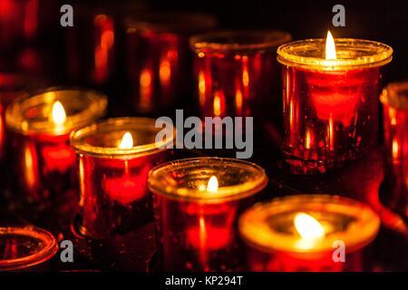 Lit candle set inside a San Cristobal de La Laguna cathedral - Stock Photo