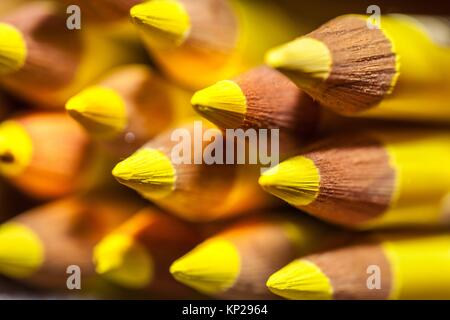 colour pencils stacked in horizontal position - Stock Photo