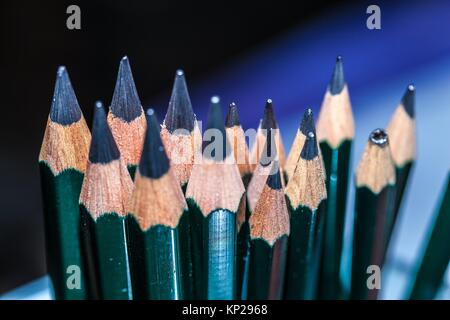 colour pencils stacked in vertical position - Stock Photo