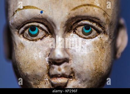 male child wooden articulated doll face - Stock Photo