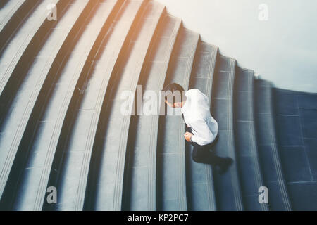 Businessman running fast upstairs Growth up Success concept - Stock Photo