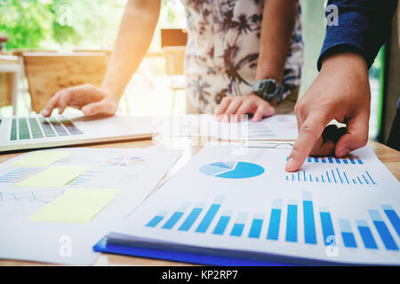 Startup business team colleagues meeting Planning Strategy Analysis discussing new plan financial on graph data - Stock Photo