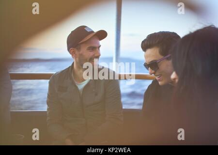 happy young student friends are laughing and enjoying their togetherness during the evening - Stock Photo