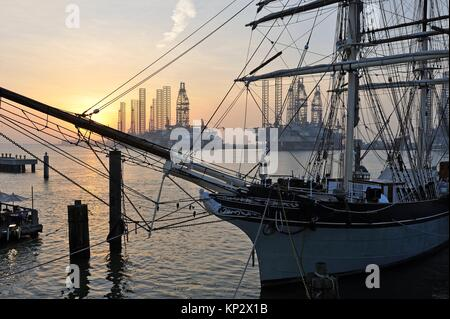 tall ship Elissa (1877), a three-masted barque moored in the port of Galveston at sunset, Galveston island, Gulf - Stock Photo