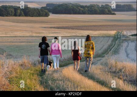 Young people walking around Mittainville, Yvelines department, Ile-de-France region, France, Europe. - Stock Photo