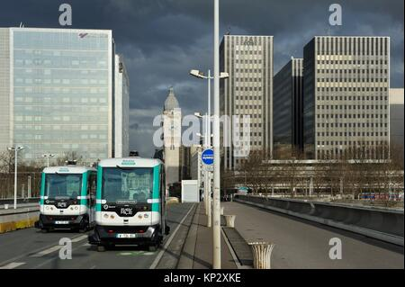 Autonomous shuttle in experiment by RATP on Charles-de-Gaulle Bridge with the Tower Clock of Gare de Lyon in the - Stock Photo