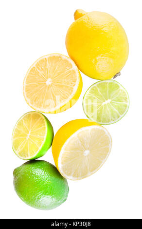 Slices and whole lemons and limes isolated on white background - Stock Photo