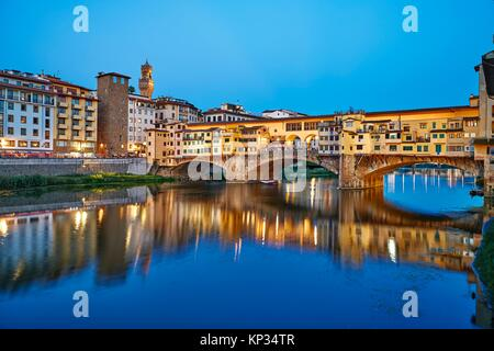 The Ponte Vecchio (´Old Bridge´) is a medieval stone closed-spandrel segmental arch bridge over the Arno River, - Stock Photo