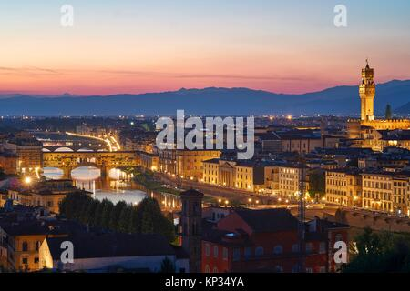 Florence cityscape at sunset with Palazzo Vecchio (old Palace) and the river Arno. Tuscany, Italy - Stock Photo
