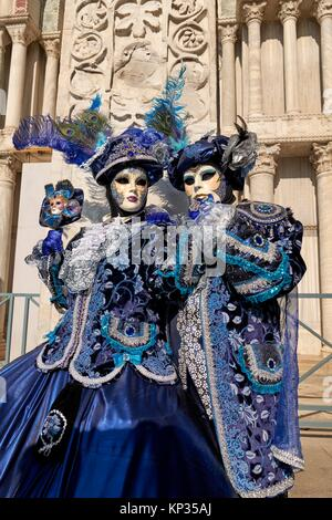 Masks at the Venice Carnival in St. Mark´s Square, Italy - Stock Photo