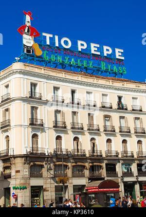 Tío Pepe neon sign, Puerta del Sol, Madrid, Spain - Stock Photo