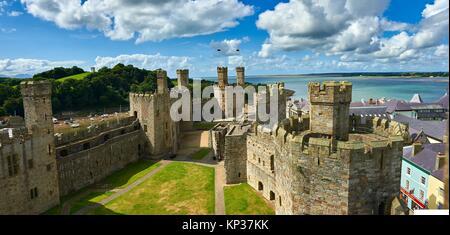 Caernarfon or Carnarvon Castle built in 1283 by King Edward I of England, Gwynedd, north-west Wales,. - Stock Photo